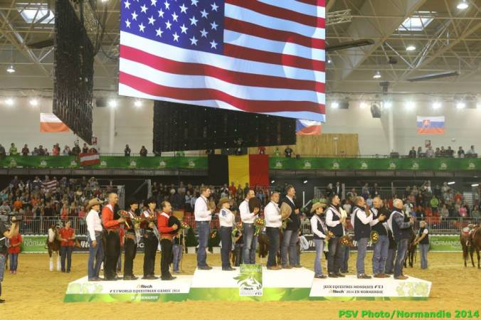 A patriot sight to see the American flag over some cowboys. Photo courtesy Dirk Caremans/FEI